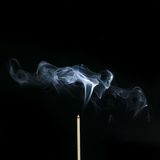 Incense Stick with Smoke on Black Background Royalty Free Stock Photos