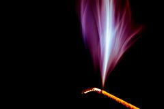Incense stick. An incense stick in a time exposure Royalty Free Stock Images