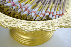 Incense stick and yellow candles Stock Images