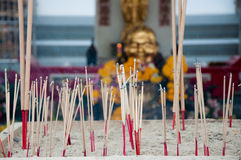Incense Sticks. Burning Incense Sticks at a Buddhist Temple in Thailand Stock Photos