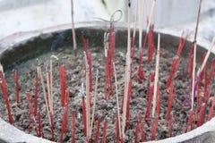 Incense sticks. Burning incense sticks in a jar Royalty Free Stock Photo