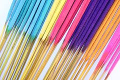 Incense Sticks. A selection of brightly colored incense sticks royalty free stock images