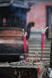 Incense sticks. Burning red incense or joss sticks Stock Photo
