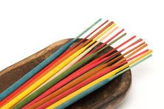 Incense sticks. In various colours stock photos