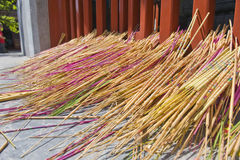 Incense sticks against gate Stock Photos