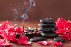 Incense sticks for aromatherapy spa azalea flowers black massage Royalty Free Stock Photo