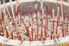 Incense sticks in ashes bucket Stock Image