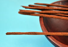 Incense sticks on blue background Royalty Free Stock Images