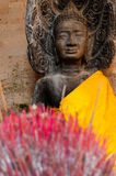 Incense sticks with Buddha in the back Stock Image