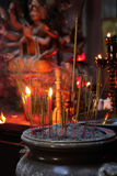 Incense sticks in Buddhist temple. Close up of incense sticks in a Buddhist temple stock photography