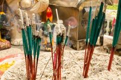Incense sticks burn around the shrine Stock Image