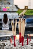 Incense sticks in the incense burner at the temple Stock Photos