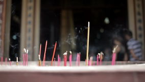 Incense sticks burning close-up stock footage