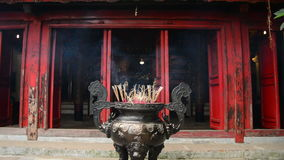 Incense Sticks Burning in Giant Pot in Front of Buddhist Temple stock video footage