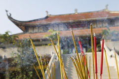 Incense Sticks Burning Outside of Temple Royalty Free Stock Photography
