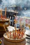 Incense Sticks Burning with Smoke at Wat Pra Khaeo Kamphaeng Phet Province, Thailand Royalty Free Stock Photography
