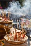 Incense Sticks Burning with Smoke at Wat Pra Khaeo Kamphaeng Phet Province, Thailand Stock Photo