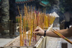 Incense sticks burning at a Taoist temple of Wong Tai Sin, Hong Kong. Royalty Free Stock Photos