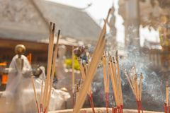 Incense sticks burning with white smoke on incense pot Royalty Free Stock Photography
