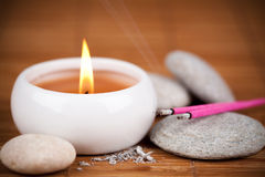 Incense sticks and candle Royalty Free Stock Photos