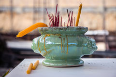 Incense sticks with candle in bowl Stock Image