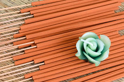 Incense sticks with candle on the mat Royalty Free Stock Photos