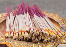 Incense sticks on gold tray with pedestal Royalty Free Stock Photography