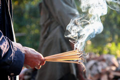 Incense sticks. Hand holding incense sticks for worship, praying god of Asia religion Stock Photos