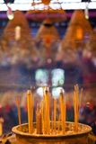 Incense sticks at Man Mo Temple, Hong Kong. Smoke rising from burning incense sticks in Man Mo Temple, Hong Kong Stock Photo
