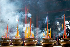 Incense sticks in pagoda. Smoking prayer sticks in copper urns. Thien Hau Pagoda, Ho Chi Minh, Vietnam Stock Photos