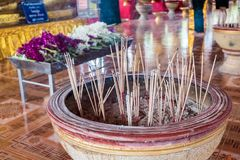 Incense sticks are in pots. Smoke is floating Royalty Free Stock Image