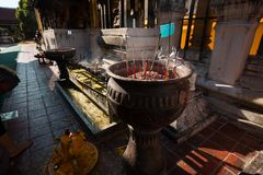 Incense sticks in pots to hallow. Of  Wat Phra That Lampang Luang in Thailand Royalty Free Stock Photos