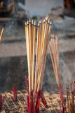 Incense sticks and smoke in ashes bucket Royalty Free Stock Images