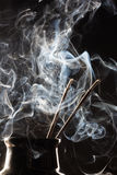 Incense sticks and smoke Royalty Free Stock Image