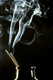 Incense sticks and smoke Stock Photography