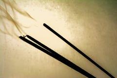 Incense sticks smoldering Stock Image