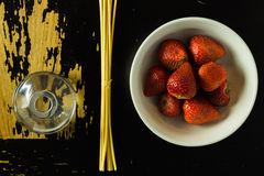 Incense sticks and strawberries royalty free stock images