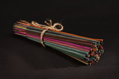 Incense sticks tied together with rope. Group of colourful incense sticks tied together with rope on black background Royalty Free Stock Photos