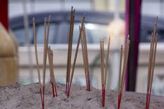 Incense sticks with white smoke in pot Stock Photography