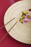 Incense sticks on wooden plate Stock Images
