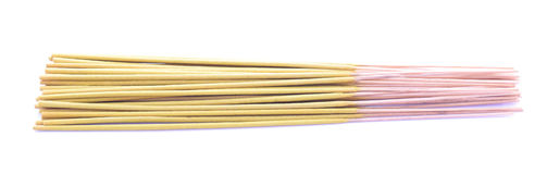 Incense sticks. Yellow incense stiks isolated on white Stock Image
