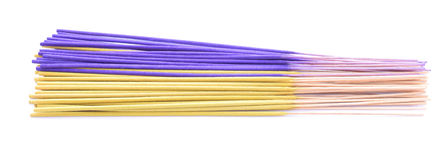 Incense sticks. Yellow and violet isolated on white Royalty Free Stock Image
