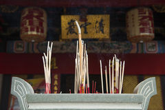Incense in vase at chinese shrine Stock Photo