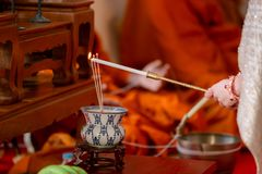 Incense was lit by the fire of red candle. incense.Incense and smoke for worship stock images