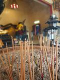 Incense that was lit to show respect in pots stock images