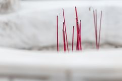 Burning red sticks for worship in buddhist temple. Royalty Free Stock Photography