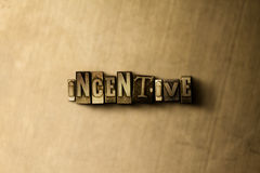 INCENTIVE - close-up of grungy vintage typeset word on metal backdrop. Royalty free stock illustration.  Can be used for online banner ads and direct mail Royalty Free Stock Photography