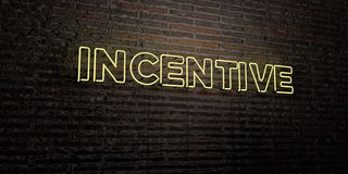 INCENTIVE -Realistic Neon Sign on Brick Wall background - 3D rendered royalty free stock image. Can be used for online banner ads and direct mailers Royalty Free Stock Photos