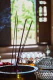 Incentive sticks, Bali, Indonesia. Interior with incentive sticks and aromatic oil Royalty Free Stock Images