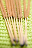 Incentive sticks details. Incentive sticks on a green fabric in close up mode stock images
